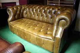 Ремонт дивана кожей
